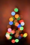 Abstracte die Kerstboom van bokehlichten wordt gemaakt Stock Foto