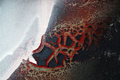 Abstracte die vormen op een muur door gebarsten droge verf wordt gevormd Royalty-vrije Stock Afbeeldingen