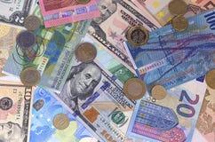 Abstracte dollar euro Zwitserse frank en muntstukkenachtergrond Stock Afbeeldingen