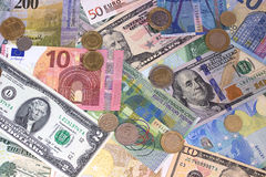 Abstracte dollar euro Zwitserse frank en muntstukkenachtergrond Royalty-vrije Stock Foto
