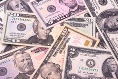 Abstracte dollarrekeningen van verschillende benamingenachtergrond stock fotografie
