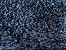 Abstracte donkere zwarte grijze gekleurde achtergrond van elegant huid of plastiek Royalty-vrije Stock Afbeeldingen