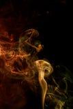 Abstracte gele rode rook van aromatische stokken Royalty-vrije Stock Afbeelding