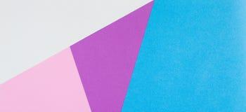 Abstracte geometrische document achtergrond Blauwe, roze en purpere kleuren Stock Foto's