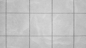 Abstracte geweven materiële oppervlakte als achtergrond van een geometrische symmetrische patroon grote vierkanten en dunne verde stock foto's