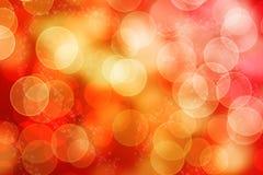 Abstracte glanzende bokeh rode gele achtergrond stock fotografie