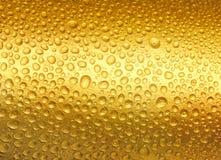 Abstracte gouden dalingen van water. Stock Afbeelding