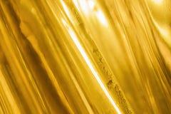 Abstracte gouden glasachtergrond Royalty-vrije Stock Fotografie