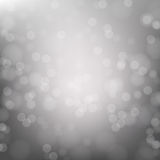 Abstracte grijze cirkelbokehachtergrond Stock Foto