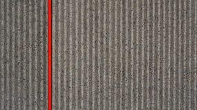 Abstracte grijze concrete rode streep als achtergrond Royalty-vrije Stock Afbeelding