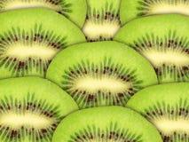 Abstracte groene achtergrond met ruwe kiwiplakken Royalty-vrije Stock Afbeelding