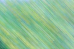 Abstracte groene en gele natuurlijke achtergrond met bewegingseffect Stock Afbeeldingen