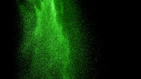 Abstracte groene poederexplosie op zwarte achtergrond Stock Foto