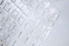 Abstracte high-tech achtergrond Een blad van transparant plastiek of glas met de verwijderde gaten Laserknipsel van Stock Foto