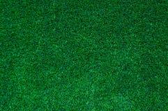 Abstracte hoogste menings groene kleur van kunstmatige grasachtergrond Royalty-vrije Stock Afbeeldingen