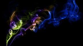 Abstracte kleurrijke achtergrond die met echte rook wordt gemaakt Royalty-vrije Stock Afbeelding