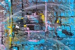 Abstracte kleurrijke blauw, purper, geel, wit en blackpainted bakstenen muur Royalty-vrije Stock Fotografie