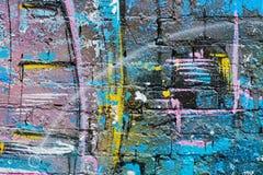 Abstracte kleurrijke blauw, purper, geel, wit en blackpainted bakstenen muur Stock Fotografie