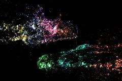 Abstracte kleurrijke die Waterplons op zwarte wordt geïsoleerd Royalty-vrije Stock Afbeelding