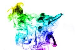 Abstracte kleurrijke rookvorm over wit stock foto