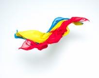 Abstracte kleurrijke stukken van stof het vliegen Stock Foto's