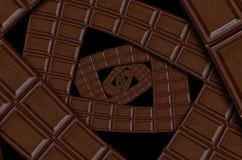 Abstracte melkchocola vierkante die spiraal van chocoladereep wordt gemaakt Draaisamenvatting Chocolade achtergrondpatroon Donker royalty-vrije stock afbeeldingen