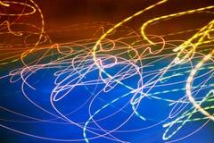 Abstracte motie vage lichten op blauw Royalty-vrije Stock Fotografie
