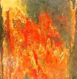 Abstracte multi-colored waterverf geschilderde achtergrond in heldere oranje en gele kleuren Stock Foto's