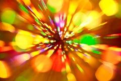 Abstracte multicolored feestelijke lichten op een gele en oranje achtergrond royalty-vrije stock afbeeldingen