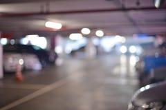Abstracte onscherpe achtergrond van parkeerterreinen in winkelcomplex stock fotografie