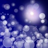 Abstracte onscherpe lichten op blauwe donkere achtergrond Stock Foto