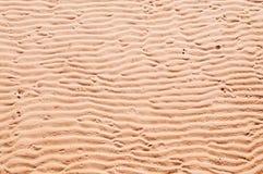 Abstracte onvolmaakte de textuurachtergrond van de zandgolf stock foto's