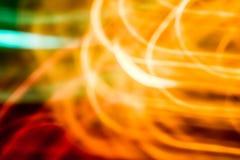 Abstracte oranje, rode, groene vage achtergrond Stock Fotografie
