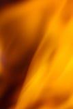 Abstracte oranje vurige golfachtergrond Stock Afbeelding