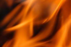 Abstracte oranje vurige golfachtergrond Stock Fotografie
