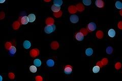 Abstracte rode en blauwe bokehtextuur op zwarte achtergrond royalty-vrije stock foto