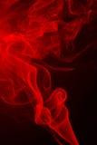 Abstracte rode rook van aromatische stokken Stock Foto's
