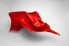Abstracte rode stof in motie Stock Foto