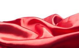 Abstracte rode zijde of satijnstof Royalty-vrije Stock Foto's