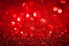 Abstracte rood fonkelde Kerstmisachtergrond royalty-vrije stock fotografie