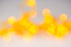 Abstracte sinaasappel vage lichte achtergrond met cirkels Royalty-vrije Stock Afbeelding