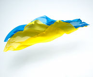 Abstracte stukken van het blauwe en gele stof vliegen Stock Afbeeldingen