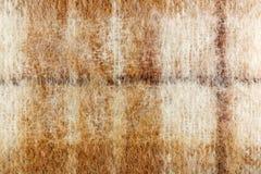 Abstracte textuur van gebreide wol met bruine strepen Achtergrond van natuurlijke wol Stock Fotografie