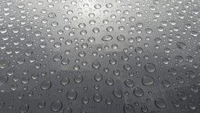 Abstracte textuur van waterdaling op de lijst na regen Royalty-vrije Stock Foto