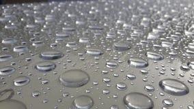 Abstracte textuur van waterdaling op de lijst na regen Stock Foto's