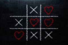 Abstracte Tic Tac Toe Game Competition met hartvorm in Ce stock afbeeldingen