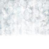 Abstracte zilveren Kerstmis, de winterachtergrond met vage lichten Royalty-vrije Stock Afbeelding