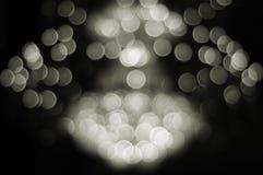 Abstracte zwart-witte bokeh als achtergrond van kroonluchter Stock Afbeeldingen