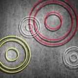 Abstracte zwarte achtergrond met rode gele en witte ringen of cirkels vector illustratie