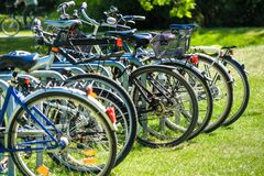 Abstracted image with intentionally low depth of field from a group of bicycles parked on the lawn of a public park Royalty Free Stock Image